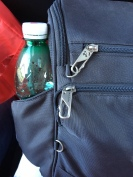 Easy to wipe exterior, latching closures and zip out water bottle pocket.