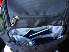 Extra outer pocket, inner pocket, RFID slots, place for phone, wallet and small camera.